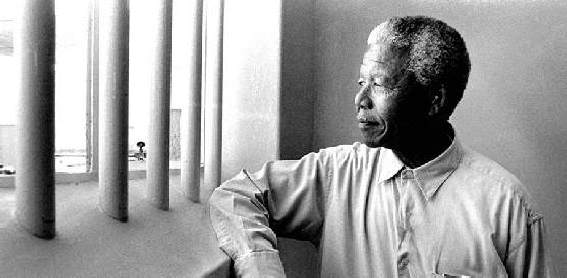 Nelson Mandela revisits his prison cell on Robben Island in 1994, four years after his release from prison.